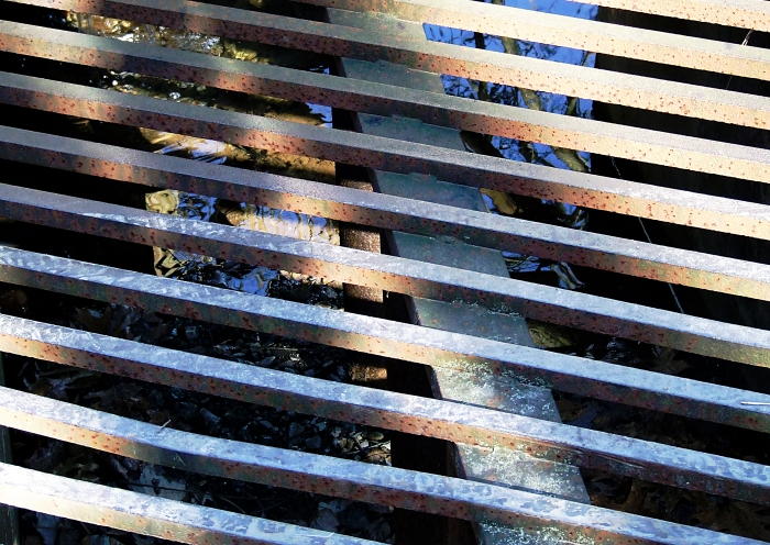 grating over a drainage ditch