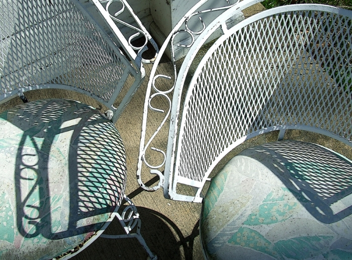 cast iron chairs with faded cushions