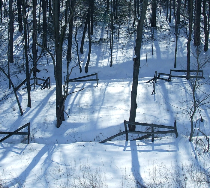 the remains of an old horse corral in the snow