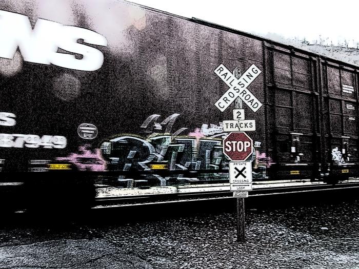 Norfolk Southern boxcar with graffiti
