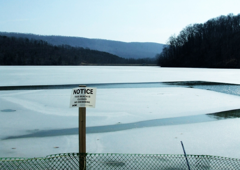 Canoe Lake in winter - Beach Closed notice