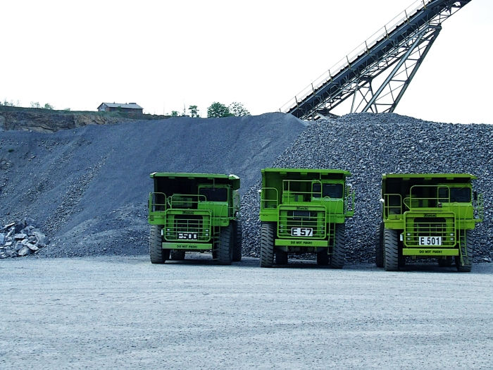 green quarry trucks at a limestone quarry