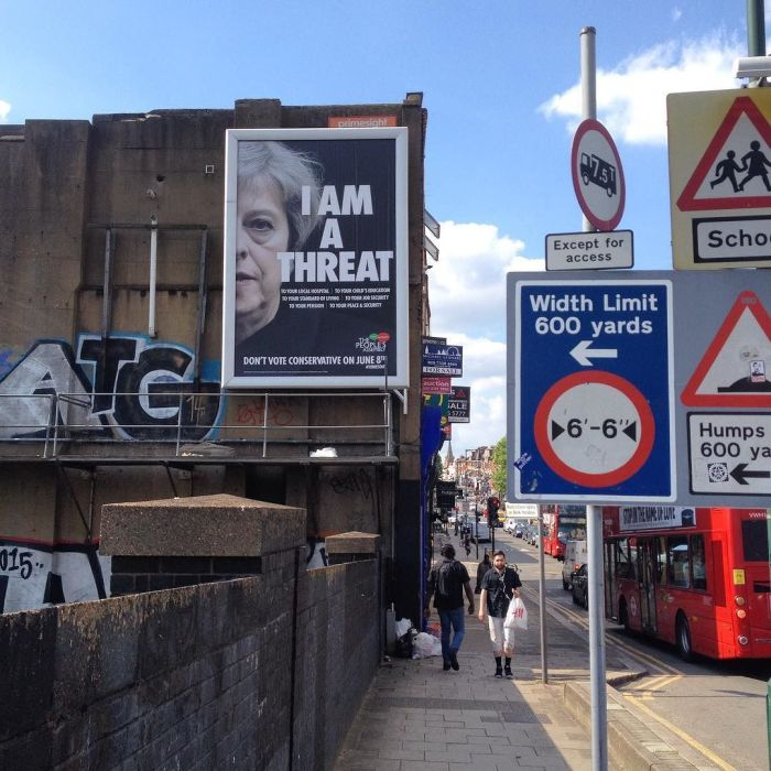 London street sign with an anti-Teresa May sign that reads, I am a threat