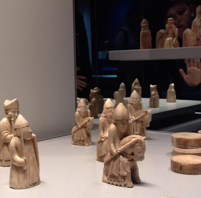 Chess pieces from the famous Lewis set in the British Museum appear to regard the people on the other side of the glass with alarm and hostility.